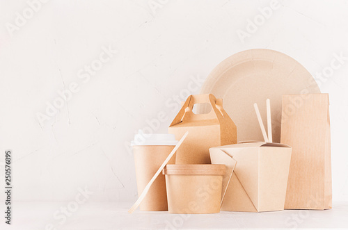 Food branding identity mockup in light modern style - blank cardboard container, bowl, box for fast food, drink cup, plate, chopsticks on white wood board. - 250576895