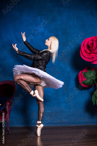 Ballerina girl in black tights white tutu and leather jacket. Concept of dance and body, ballet dancer  © T.Den_Team
