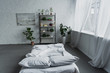 Leinwanddruck Bild - modern interior design of bedroom with rack, plants, bed, brick wall and copy space