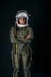 Young astronaut woman with helmet in studio