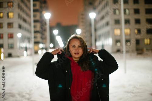 obraz lub plakat Brunette girl posing at the night winter street