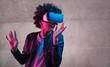 Teenager in VR glasses gesturing and looking away