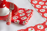 napkin with cherries and decorative fork