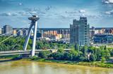 BRATISLAVA, SLOVAKIA - JULY 2011:B ridge of the Slovak National Uprising, UFO Bridge, over Danube river. Bratislava attracts 1 million tourists annually - 250666016