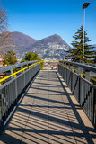Elevtated Walkway and Mountain Top in Lugano, Switzerland. - 250669293