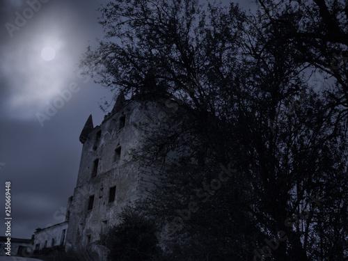 Leinwanddruck Bild Creepy old tower at night