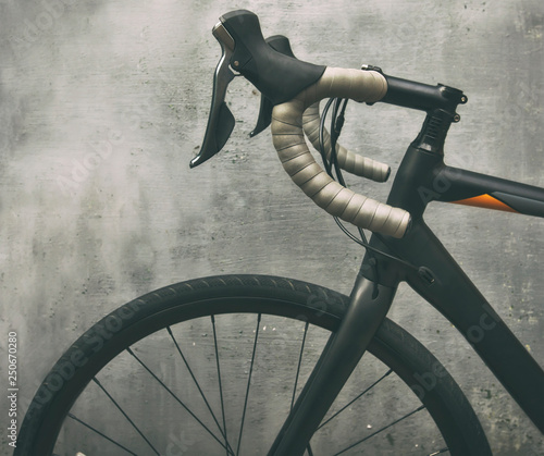 A black race bike in front of metal gray wall © SkyLine