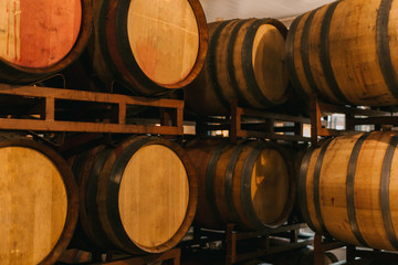 Wine fermentation tanks placed on the floor in the wine making factory