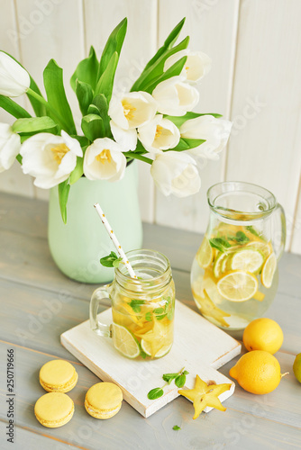 lemonade and macaroons on the table next to the tulips © Aleksandr