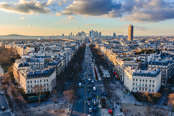 Magnificent look from Arc de Triomphe (Triumphal Arc) towards the la défense - the parisien trade quarter, before sunset, with beatiful clouds