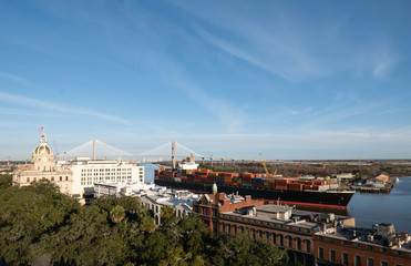 Cityscape of Savannah Georgia riverfront with large freight ship