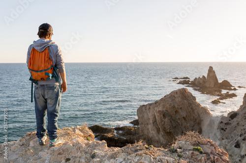 Leinwanddruck Bild Man exploring Spanish coastline, Cabo de Gata - Nijar Natural Park, Spain
