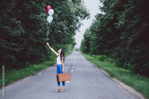 Woman with balloons at summer