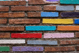 Brick wall painted into bright colours