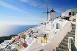 Santorini landscape with white houses and windmill, Oia Town, Santorini Island, Cyclades, Greece.
