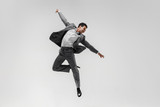 Happy businessman dancing in motion isolated on white studio background. Flexibility and grace in business. Human emotions concept. Office, success, professional, happiness, expression concepts