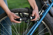 Woman locking bicycle with combination lock