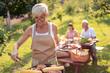 Leinwandbild Motiv Senior woman cooking meat for family