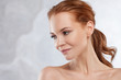 Redhead girl beauty portrait, skin care concept.