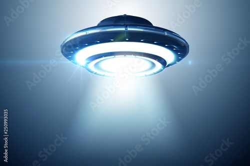Illustration of flying saucer emitting light - 3d rendering © Elnur