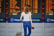 Leinwanddruck Bild - Young woman in international airport