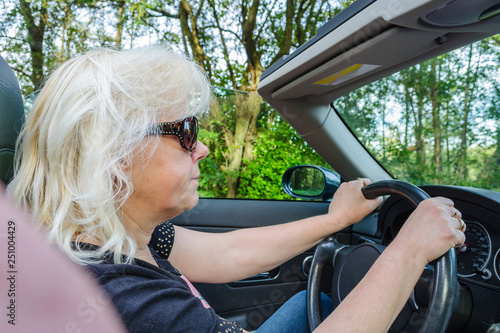 Woman with blond hair in convertible © JFsPic