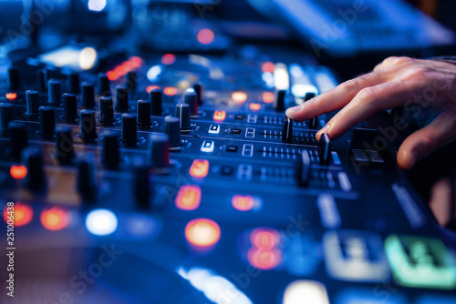 Sound operator hands at the volume control panel - 251006438
