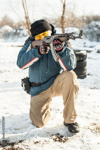 Soldier with kalashnikov riffle machine gun on outdoor shooting range © guruXOX