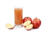 apple juice - sliced ​red apples and a glass of naturally cloudy apple juice in front of white background