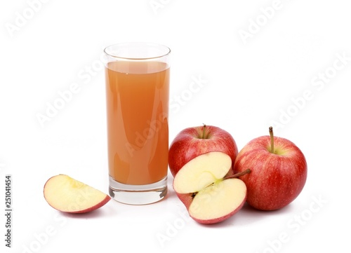 apple juice - sliced ​red apples and a glass of naturally cloudy apple juice in front of white background - 251041454