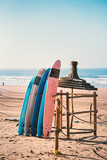 Different colors of surf on a the sandy beach in Casablanca - Morocco. Beautiful view on sandy beach and ocean. Surf boards for renting. Surfer school.