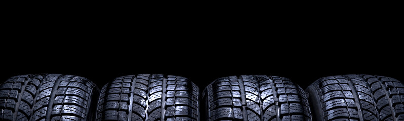 Car tires isolated panorama on black background © Alex Tihonov
