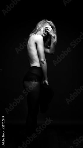 obraz lub plakat sexy girl on dark background in Studio