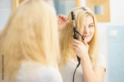 Woman using hair curler