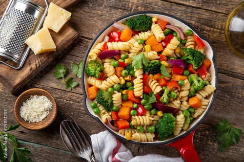 pasta with vegetables ( bell pepper, green peas, broccoli, pumpkin and corn) on pan