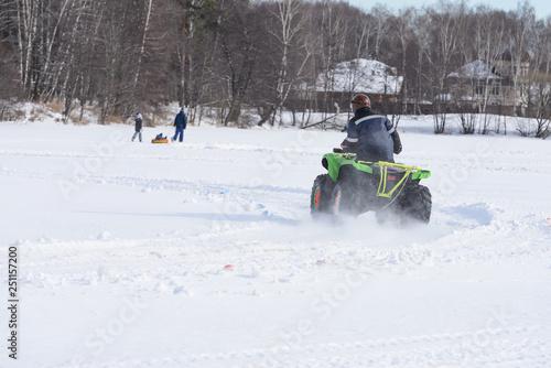 dirt bike racing on ice with snow