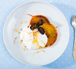 Caramel orange slices with berries and yogurt © JackF