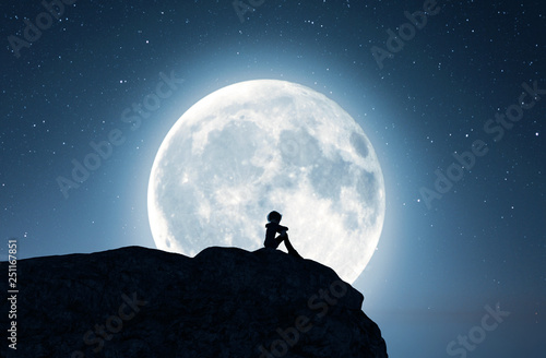 Lonely girl sitting alone on the cliff and looking to the moon,3d rendering
