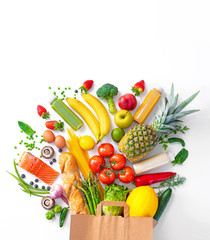 Shopping bag with groceries full of fresh vegetables and fruits