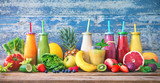 Colorful freshly squeezed fruits and vegetables smoothies with ingredients for healthy eating