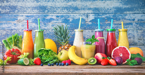 Leinwandbild Motiv Colorful freshly squeezed fruits and vegetables smoothies with ingredients for healthy eating