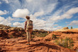 Leinwandbild Motiv Hiker in Canyonlands National park, needles in the sky, in Utah, USA