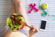 Young woman eating homemade healthy salad at home, Healthy lifestyle, diet concept