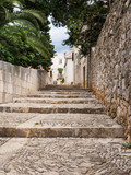 Fototapeta Na drzwi - Old street in Sucuraj, Hvar island, Croatia with stairs © sleepyhobbit