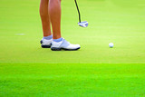 The woman professional player golf putting