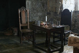 table and chairs in castle