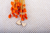 Bunch of dried orange color flower and heart shaped
