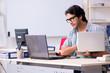 Leinwanddruck Bild - It specialist working in the office