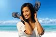 Attractive Asian girl on the coastline