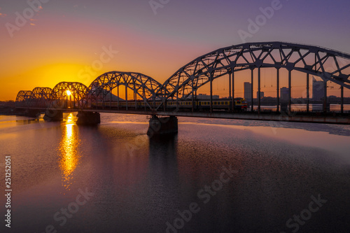 mata magnetyczna A view of the Railway Bridge over Daugava River during Sunset in Riga, Latvia